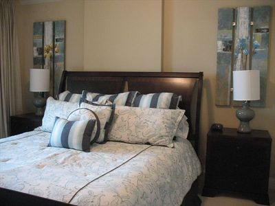 Master Bedroom with King Bed, TV and Balcony Access Overlooking Marina