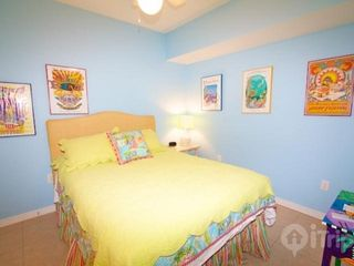 "Orange Beach condo photo - Queen sized bed and 20"" flat screen TV"