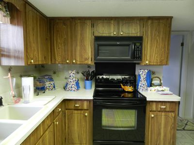 Fully stocked Kitchen-glass top range and oven, microwave oven, blender, toaster