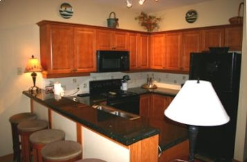 CONDOS 1 & 2 have similar kitchen layouts with granite counters.