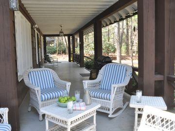 Covered porch overlooking the big front yard with stunning pine trees.
