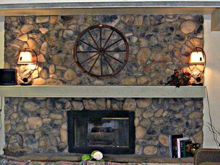 Silverthorne house photo - Gas fireplace with stone chimney