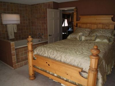 Room has queen size bed & jacuzzi bath