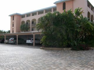 Sanibel Island condo photo - Covered Parking and cabinets in front of the cars for beach chairs and noodles.