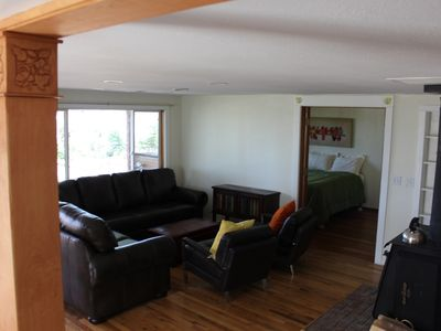 Open floor plan with huge leather wrap-around couch