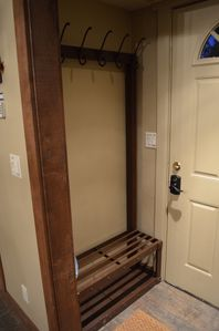 Entry with Convenient Coat & Boot Rack.