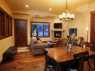 "The Canyons townhome photo - Dining / Living room with 40"" flat screen and fireplace"