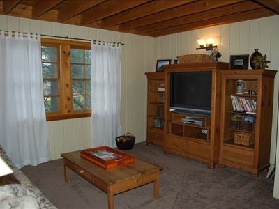 Family Room also includes Cable, DVD collection, books, games in bottom drawers