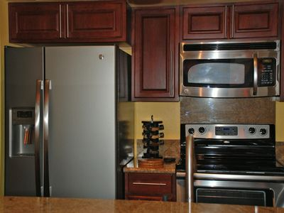 Gorgeous kitchen remodel with granite counter and new refrigerator