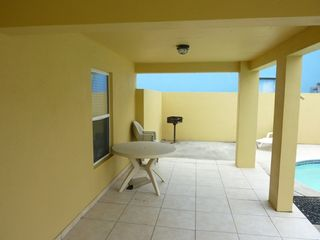 South Padre Island house photo - Oversize covered patio with ample seating and BBQ grill