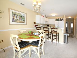 Tybee Island condo photo - Dining area, kitchen, hall to bedrooms
