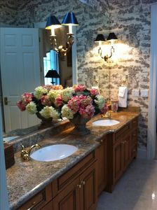 Dual vanity sinks with custom cabinetry
