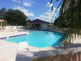 Punta Gorda condo photo - Heated pool with gas grill in the gazebo on the left