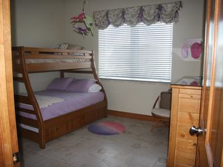 Pensacola Beach house photo - Bunk room on 2nd level with double, trundle and 1 T bunk. Uses hall bath.