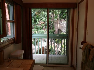 Cottage bathroom with view to outside shower