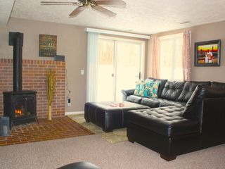 Crystal Mountain, Thompsonville lodge photo - Family room with gas stove. Relax and unwind..You're on vacation!!