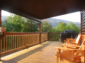 Relax on the Covered Porch after a dip in Hot Tub
