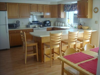 Well appointed kitchen with dishwasher,trash compactor and open to livingroom.