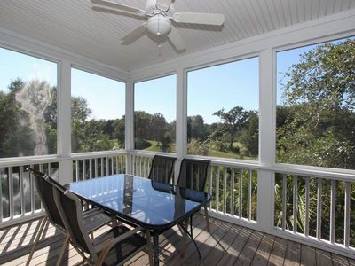 Screened Porch right off the kitchen overlooking the golf course -cards anyone?