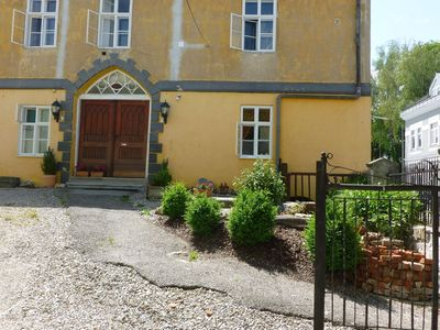 Holiday house with 4 apartments for 17 persons in a historic school building.