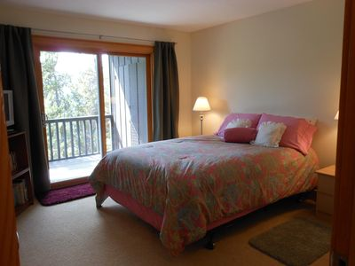 Master bedroom suite has sliding glass doors to private deck.