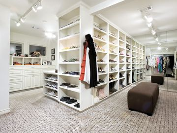 2 master closets. This is hers and will be empty for your...