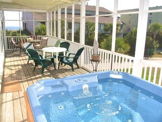 Six person hot tub on screened in porch