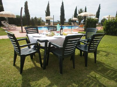 Apartments with gardens, terraces, swimming pool, solarium and Garage