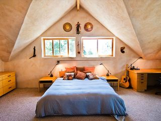 Taos house photo - The king size bed in the master suite with views looking south towards Taos