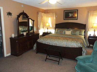 Corpus Christi house rental - Crawl into comfort in this king size bed! Master Bedroom has access to patio.