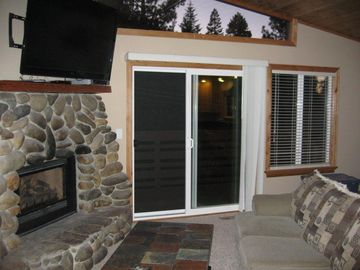 "Great Room, slider to deck, gas fireplace with heater, 55"" LED TV"
