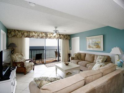 Spacious living room with Gulf view and balcony access
