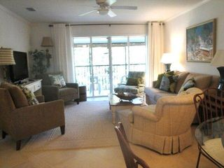"Siesta Key condo photo - Living room area with 42"" LCD TV, attached screened lanai (renovated..."