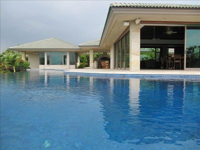 Enjoy dipping in the pool and glass walls that open up on 3 sides of the house.
