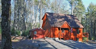 Harrison cabin photo - Authentic log home with open concept design encompassing whole main floor
