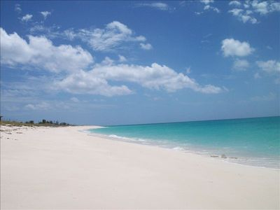 Miles of white sand and crystal water merely steps away.