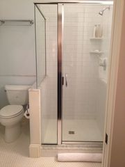 Savannah house photo - Glass stall shower with marble detail