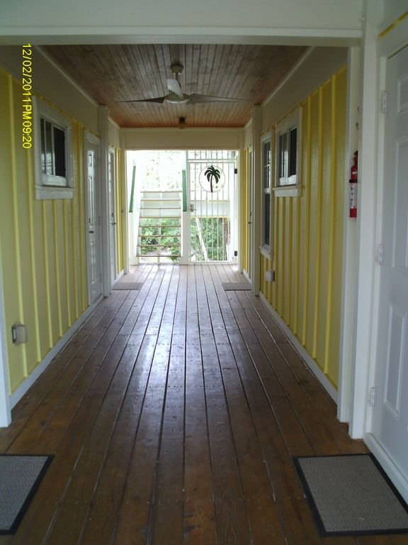 Open air breezeway on second floor provides access to 4 bedroom suites.