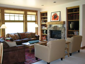 Crested Butte condo rental - large living area with gas fireplace, flat screen tv, stereo system, books, dvds