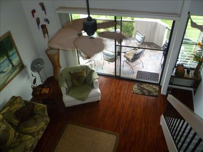 View of living room and tiled lanai from upstairs bedroom