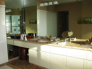Double sinks in the master bathroom with a lot of natural light for the vanity.