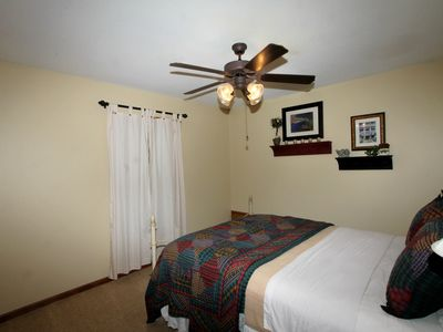 Spacious guest bedroom with queen bed and quite ceiling fan w abundance of light