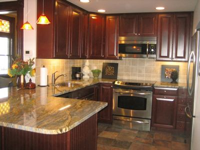 New-fully equipped cherry kitchen ss appliances granite counters-tile backsplash