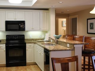 Kingston Plantation condo photo - Kitchen with granite counter tops and high-end appliances.
