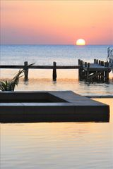 Roatan hotel photo - Sunset view from infinity Pool