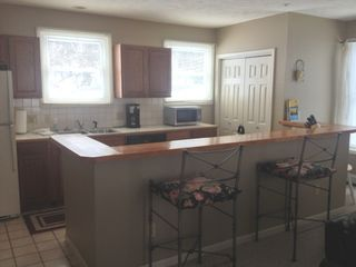 Onekama condo photo - Fully equipped kitchen with all your cooking, baking and dining needs.