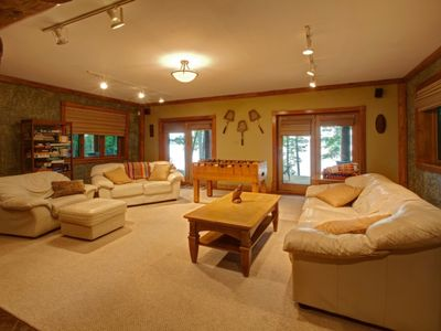 Lower level family room, fooseball, flat screen and doors to patio and lake.