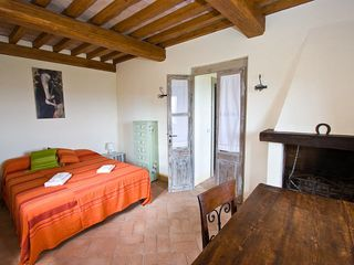 Penna in Teverina villa photo - Downstairs double room with fireplace and adjacent full bath