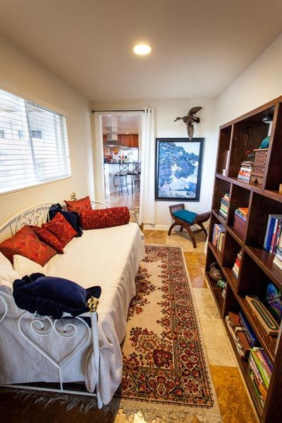 Library w/daybed & trundle below on 1st floor off living room. Sleeps 2