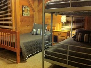Left: The upstairs middle bedroom has a bunk bed and twin bed. Sleeps three.